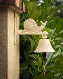 Stary rocznika doorbell z postacią ślimaczek na wierzchołku obraz royalty free