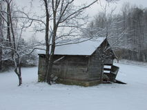Stary Rolny budynek z śniegiem Zdjęcie Stock