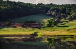 Stary rolny pobliski mały jezioro w Moldova Fotografia Royalty Free