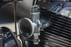 Stary silnik i swój karburator Zdjęcia Stock