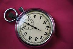 Stary stopwatch odizolowywający na czarnego tła odgórnym widoku Zdjęcie Royalty Free