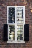 Stary szklany okno w kamiennej ścianie w Holandia Obraz Stock