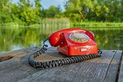 Stary telefon w naturze Obrazy Royalty Free
