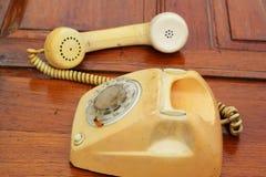 Stary telefonu rocznika styl na drewnianej podłoga Fotografia Royalty Free