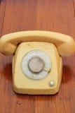 Stary telefonu rocznika styl na drewnianej podłoga Zdjęcia Royalty Free
