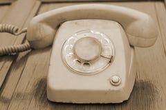 Stary telefonu rocznika styl na drewnianej podłoga Obraz Royalty Free