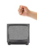 Stary TV i pięść Obraz Stock