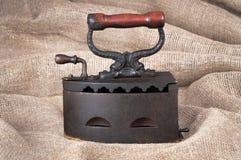 Stary węgla żelazo na tkaniny tle Obrazy Stock