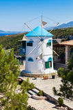 Stary wiatraczek w Agios Nikolaos blisko błękit jam w Zakynthos Zan Zdjęcie Stock
