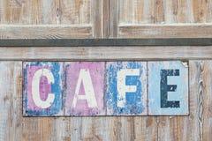 Stary wietrzejący kawiarnia znak Zdjęcie Royalty Free