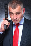 Stary zabójca w kostiumu i krawata ono uśmiecha się Fotografia Stock