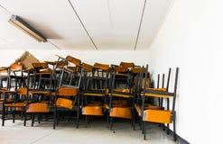 Stary zaniechany krzesło w szkole Obraz Royalty Free