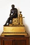 Stary zegar i statua Zdjęcia Stock