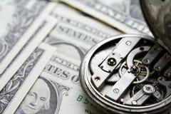 Stary zegarek Na pieniądze tle Obraz Royalty Free