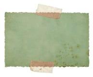Stary zielonego papieru prześcieradło z taśmą odizolowywającą na bielu Obraz Stock