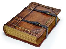 Starzejąca się skóry książka z patkami i ozłacać papierowymi krawędziami - kłaść na stole odizolowywającym fotografia stock