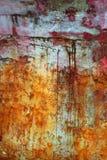 starzejąca się zielonej grunge farby czerwona tekstury ściana Obraz Royalty Free