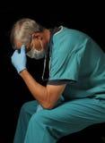starzejący się czerń lekarki środek nad posadzonym Zdjęcia Royalty Free