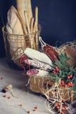 Starzejący się mięsa w drewnianym pudełku z świeżymi chlebami i winem Zdjęcie Royalty Free