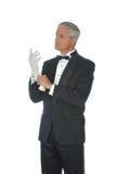 starzejący się rękawiczek mężczyzna środkowy kładzenia tux biel Obrazy Royalty Free
