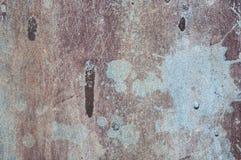 Starzeję się rdzewiał porysowany nawierzchniowy brown błękit malującego metal tekstury tło Obrazy Stock