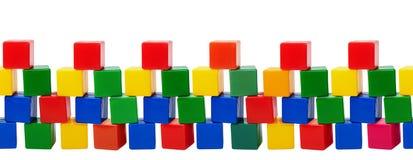 Starzy plastikowi kolorów bloki - zabawki odizolowywać na białym tle Obraz Royalty Free