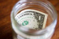 Stash της αποταμίευσης - ένα δολάριο σε ένα βάζο Στοκ φωτογραφίες με δικαίωμα ελεύθερης χρήσης