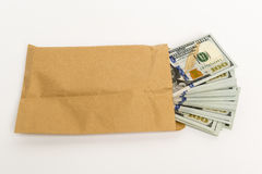 Stash of money in hundred dollar banknotes coming out of envelope Royalty Free Stock Photos