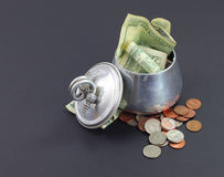 Stashing money in the sugar bowl Stock Image