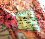 State of Arizona, USA focus macro shot on globe map for travel blogs, social media, web banners and backgrounds. State of Arizona, USA focus macro shot on globe royalty free stock images