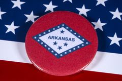 State of Arkansas in the USA. LONDON, UK - APRIL 27TH 2018: The symbol of the State of Arkansas, pictured over the flag of the United States of America, on 27th Stock Photos
