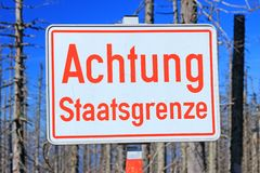 State border. Sign Attention state border on the border of Germany, Austria, Czech Republic, Bavarian Forest, Sumava National Park royalty free stock photos