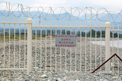State border. Sochi, Russia. The state border between Russian Federation and the Republic of Abkhazia. The inscription on the fence translates as 'Restricted stock photos