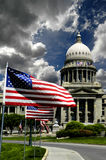 State Capital Building. With flags and sky Stock Photos