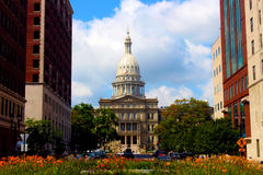 State Capitol and Flowers. The state capitol building in Lansing, Michigan, with flowers in the foreground royalty free stock photography