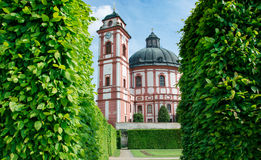 State castle Jaromerice nad Rokytnou with trees / Czech republic. Caste chappel and tower and green garden Royalty Free Stock Photos