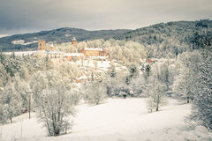 State Castle Rozmberk nad Vltavou south bohemia and church in the winter (snow) Stock Photo