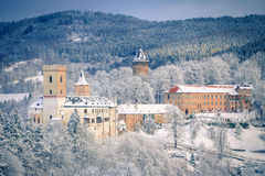 State Castle Rozmberk nad Vltavou south bohemia and church in the winter (snow) Royalty Free Stock Image