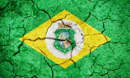 State of Ceara, state of Brazil, flag. On dry earth ground texture background Stock Photos