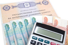 The state certificate on the maternity (family) capital, money and the calculator.  Royalty Free Stock Photo