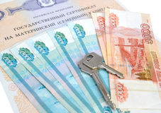 The state certificate on the maternity (family) capital, the Russian money and the keys.  Royalty Free Stock Image