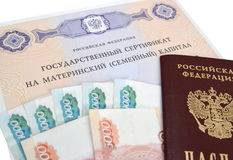 The state certificate on the maternity (family) capital, the Russian money and the passport Stock Photo
