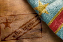 State of Congo flag and stemp Made in Congo. State of the Congo flag on a wooden background and stemp Made in Congo royalty free stock images