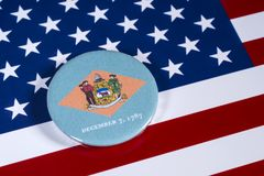 State of Delaware in the USA. LONDON, UK - APRIL 27TH 2018: The symbol of the State of Delaware, pictured over the flag of the United States of America, on 27th royalty free stock photography