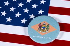 State of Delaware in the USA. LONDON, UK - APRIL 27TH 2018: The symbol of the State of Delaware, pictured over the flag of the United States of America, on 27th Stock Image