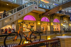 State Department Store (GUM) with the orange bike. Royalty Free Stock Photo