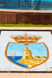 State emblem of city depicted on white tiled floor Royalty Free Stock Photos