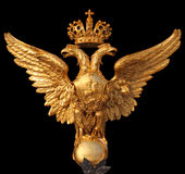 State eagle on on the bal,  Hermitage in St. Petersburg. This eagle is established on Hermitage collars in St. Petersburg. The arms of the Russia isolated on a stock image