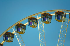State Fair. Rides at the amusement park under bright blue sky Royalty Free Stock Photo