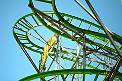 State Fair. Rides at the amusement park under bright blue sky Stock Image